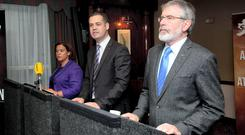 Sinn Fein TD's Deputy Leader Mary Lou McDonald TD, Finance Spokesperson Pearse Doherty TD, Sinn Féin President Gerry Adams TD, at the launch of its alternative budget for 2015 in the Davenport Hotel, Dublin. Photo: Gareth Chaney Collins