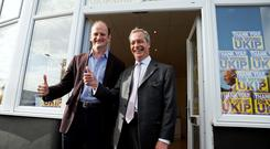 Nigel Farage (R), the leader of the United Kingdom Independence Party (UKIP) and Douglas Carswell, who won UKIP a by election last week