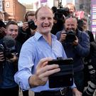 Newly elected UKIP MP for Clacton-on-Sea in Essex Douglas Carswell celebrates after winning last night's by-election, which was forced after he defected from the Conservative Party.