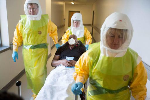 Staff from North East Ambulance Service and the Royal Victoria Infirmary, Newcastle take part in a national exercise to test Britain's readiness for an Ebola outbreak. Reuters