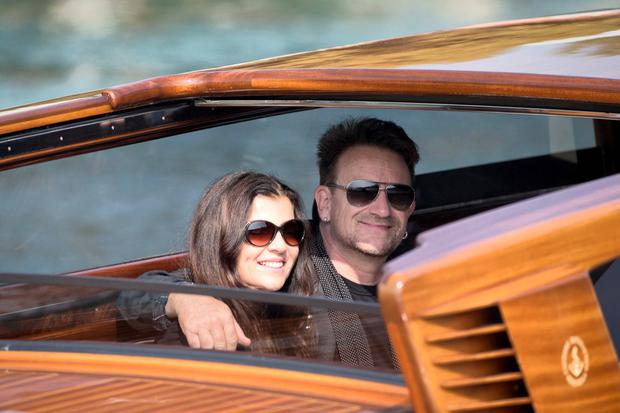 Beautiful day: Bono and Ali in Venice for the wedding of George Clooney and Amal Alamuddin
