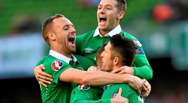 Robbie Keane is congratulated by team-mates David Meyler, Aiden McGeady and Wes Hoolahan after opening the scoring in their Euro 2016 qualifier against Gibraltar at the Aviva. Photo: Matt Browne / SPORTSFILE