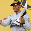 Lewis Hamilton celebrates after winning the first Russian Grand Prix in Sochi. Photo: REUTERS/Maxim Shemetov