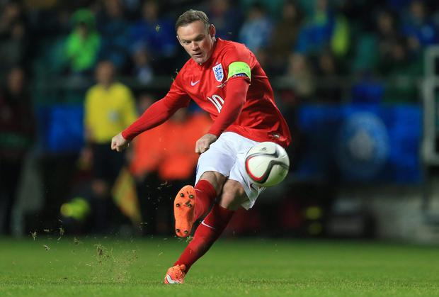 Wayne Rooney fires the ball home from a free-kick to score England's winning goal in their Euro 2016 qualifier against Estonia in Tallinn. Photo: Mike Egerton/PA Wire
