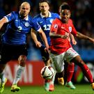 England's Raheem Sterling is pursued by Joal Lindpere of Estonia during their Euro 2016 qualifier clash victory in Tallinn. Photo: Shaun Botterill/Getty Images