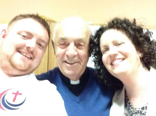 Father Brian Cusack pictured with visitors Matthew and Louise. (Photo: Facebook/Redemptorists Dundalk)