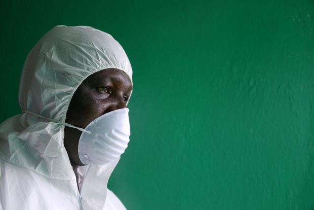 A health worker conducts an Ebola prevention in Monrovia. (Photo DOMINIQUE FAGET/AFP/Getty Images)