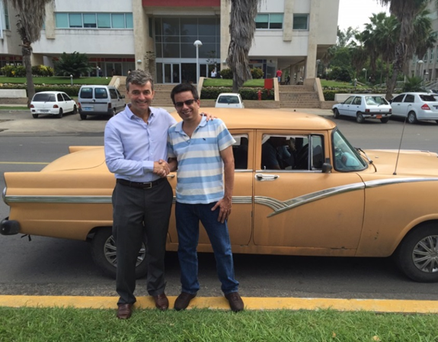 Mark Roden, of ding*, with Luis Flores, of RecargasaCuba.com following acquisition in Cuba