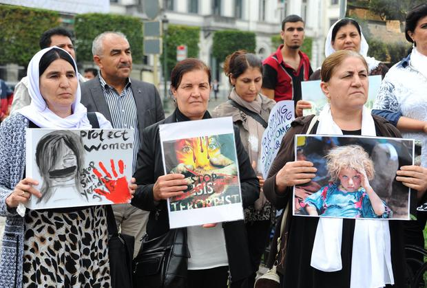 Yezidis hold banners during a recent demonstration in Brussels against Islamic State's sale of women into the sex trade. Photo: Dursun Aydemir/Anadolu Agency/Getty Images