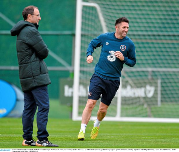 8 October 2014; Republic of Ireland's Robbie Keane with manager Martin O'Neill during squad training ahead of their UEFA EURO 2016 Championship Qualifer, Group D, game against Gibraltar on Saturday. Republic of Ireland Squad Training, Gannon Park, Malahide, Co. Dublin. Picture credit: David Maher / SPORTSFILE