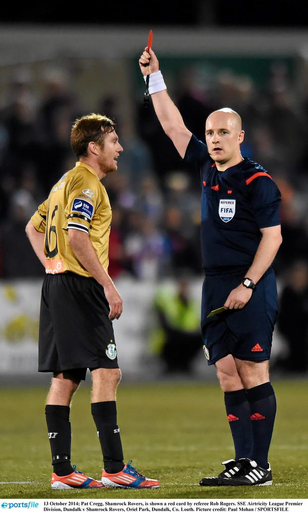 13 October 2014; Pat Cregg, Shamrock Rovers, is shown a red card by referee Rob Rogers. SSE Airtricity League Premier Division, Dundalk v Shamrock Rovers, Oriel Park, Dundalk, Co. Louth. Picture credit: Paul Mohan / SPORTSFILE