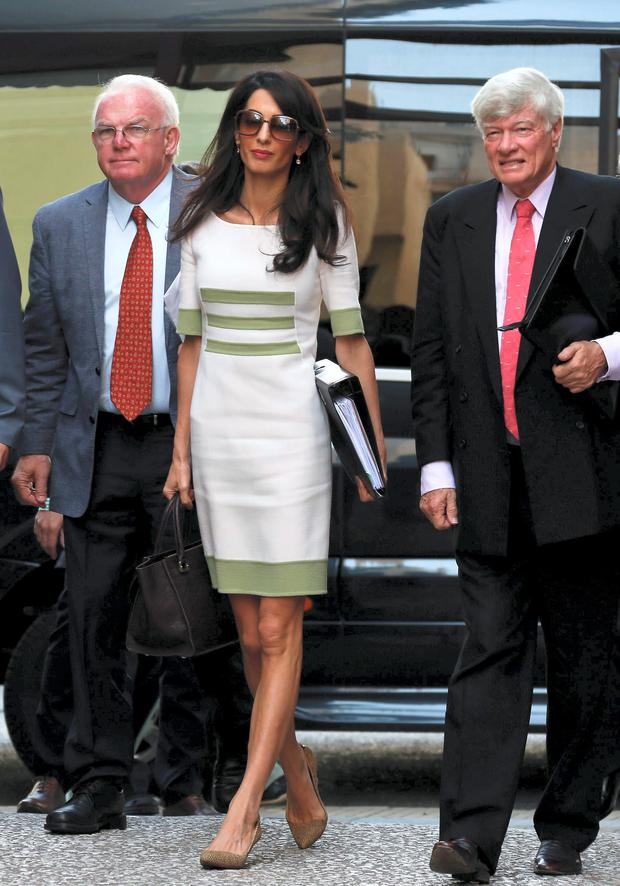Human rights lawyer Amal Alamuddin Clooney (C), Geoffrey Robertson (R), head of Doughty Street Chambers, and David Hill (L), head of the International Committee for the Reunification of the Parthenon Marbles arrive at the ministry of Culture and Sports for a meeting with Greek minister Konstantinos Tasoulas