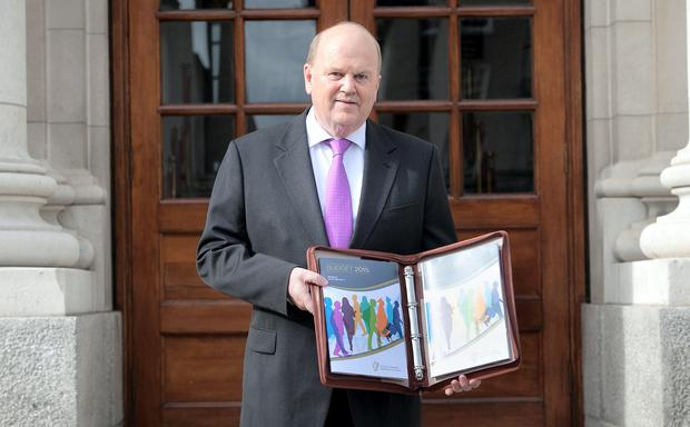 Finance Minister Michael Noonan at the announcement of Budget 2015 at Government Buildings. Photo: Gareth Chaney Collins