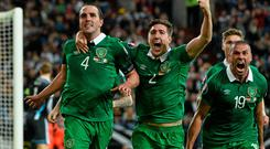John O'Shea celebrates with team-mates Stephen Ward and Jonathan Walters after scoring Ireland's equalising goal against Germany with the last kick of the game in Gelsenkirchen. Photo: David Maher / SPORTSFILE