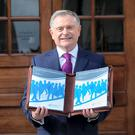 Minister for Public Expenditure Brendan Howlin with the Budget.