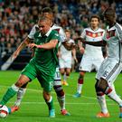 Jonathan Walters, Republic of Ireland, in action against Jerome Boateng and Antonio Rudiger, Germany