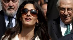 Amal Clooney is shown around the Acropolis Museum in Athens where she went to see some of the Elgin Marbles yesterday. AP Photo