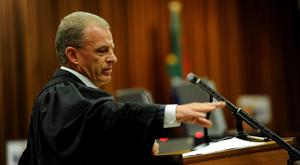 Prosecuter Gerrie Nel gestures during the sentencing hearing of Olympic and Paralympic track star Oscar Pistorius at the North Gauteng High Court in Pretoria. Judge Thokozile Masipa adjourned the session until Tuesday, when she is expected to sentence Pistorius and end a six-month, on-off trial that has captivated millions worldwide. The 27-year-old Paralympic and Olympic athlete, whose lower legs were amputated as a baby, was convicted of culpable homicide last month for the shooting of 29-year-old law graduate and model Steenkamp (REUTERS/Werner Beukes/Pool)