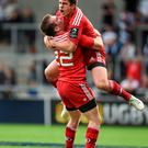 Munster's Ian Keatley, right, celebrates with team-mate JJ Hanrahan after kicking a drop goal to win the match with the last kick of the game.