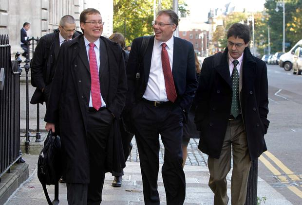 The final visit by Troika officials in October 2013. Pictured leaving the Department of Finance are IMF official Peter Breuer ( left), Craig Beaumont (centre), IMF Mission Chief for Ireland.