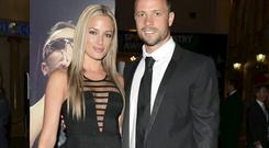 TWO SIDES: Oscar Pistorius and Reeva Steenkamp pictured in happier times before the model's death. Photo credit: Lefty Shivambu/Gallo Images/Getty Images