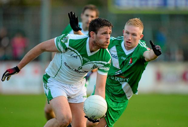Cian O'Connor, Moorefield, in action against Ray Cahill, Sarsfields