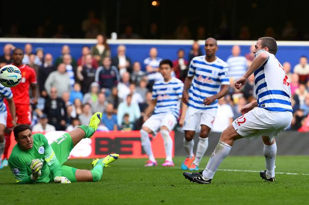 Richard Dunne of QPR scores an own goal past Alex McCarthy during the Barclays Premier League match between Queens Park Rangers and Liverpool at Loftus Road
