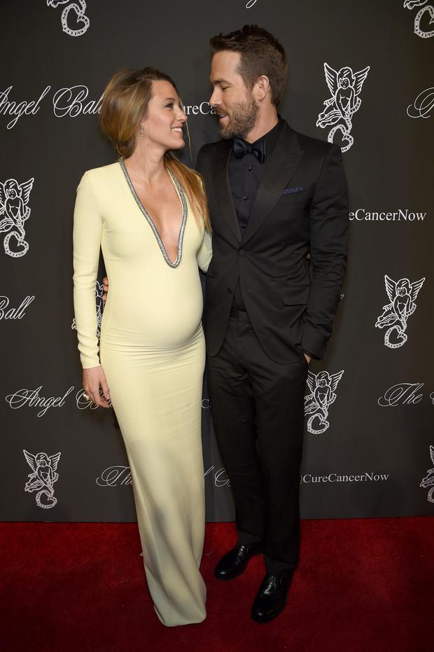 Here, she wears a Gucci gown with husband Ryan Reynolds (also in Gucci)