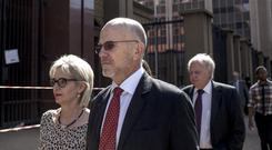 Arnold and Lois Pistorius, Oscar's aunt and uncle, arrive at the North Gauteng High Court