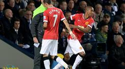 Manchester United's Angel Di Maria (left) is replaced by Ashley Young during the Barclays Premier League match at The Hawthorns last night
