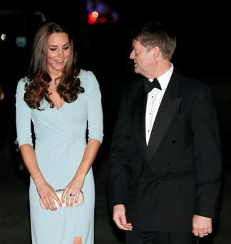 The Duchess of Cambridge with museum director Michael Dixon at the Wildlife Photographer of the Year 2014 Awards Ceremony at the Natural History Museum in London. Photo credit: Stefan Wermuth/PA Wire