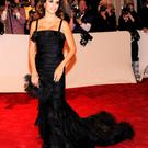 Penelope Cruz. The Spanish actress proudly arrived at the celebrated New York Met Gala in 2011 with Oscar by her side. For her, he embraced his signature Latin style with black silk organza, draped detail and a mermaid hem. She completed the look with dramatic Chopard jewels.