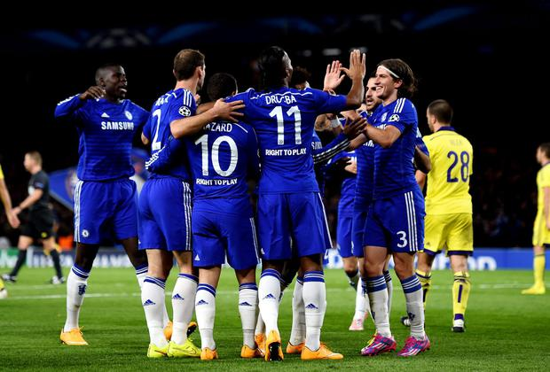 Eden Hazard is congratulated by teammates after his cross is deflected for an own goal by Mitja Viler. Photo credit: Shaun Botterill/Getty Images