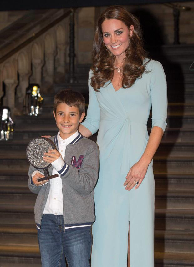 Duchess of Cambridge, presents the Young Wildlife Photographer of the Year award to Carlos Perez Naval during the Wildlife Photographer of the Year 2014 Awards Ceremony at the Natural History Museum in London. REUTERS/Arthur Edwards