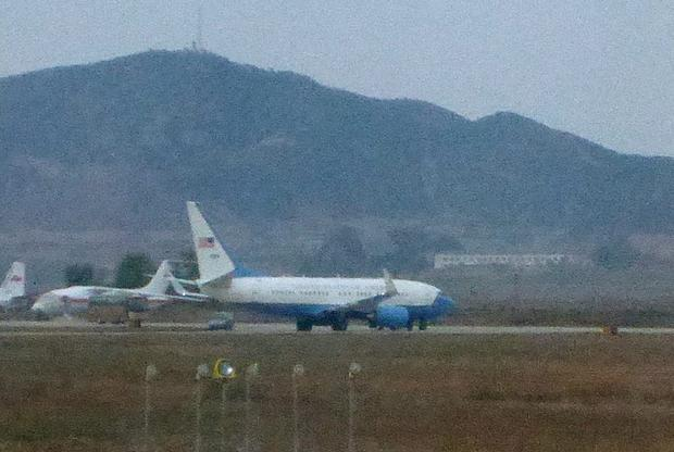 What appears to be a United States Air Force passenger jet, right, is parked on the tarmac of Sunan International Airport in Pyongyang, North Korea, Tuesday, Oct. 21, 2014. The State Department says Jeffrey Fowle, one of three Americans being held in North Korea, has been released. State Department deputy spokeswoman Marie Harf said Fowle was on his way home Tuesday after negotiators left Pyongyang. She said the U.S. is still trying to free Americans Matthew Miller and Kenneth Bae