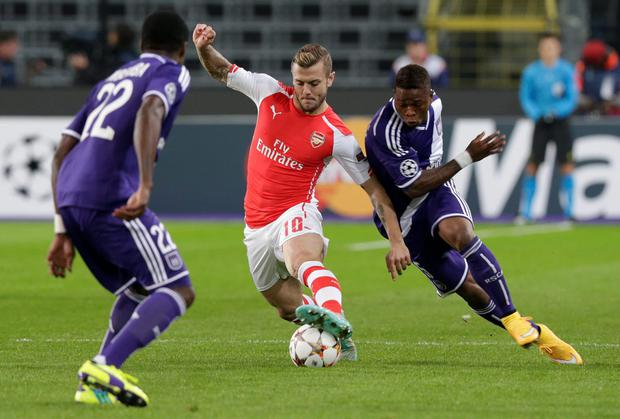 Anderlecht's Gohi Bi Zoro Cyriac, right, attempts to tackle Arsenal's Jack Wilshere during the Group D Champions League match between Anderlecht and Arsenal