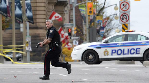 Terror came to Canada yesterday as a gunman shot dead a soldier at point-blank range before rampaging through parliament in the capital of Ottawa. AP Photo