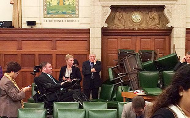 The Conservative Party caucus room is shown with its doors barracaded with furniture shortly after the shooting began (Reuters)
