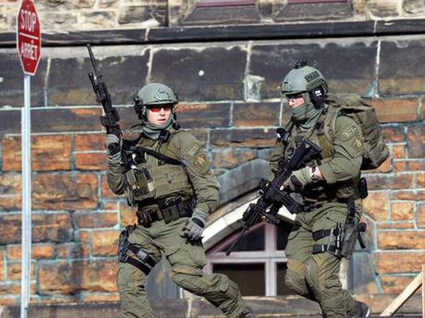 A Royal Canadian Mounted Police intervention team responds to a reported shooting at Parliament building in Ottawa