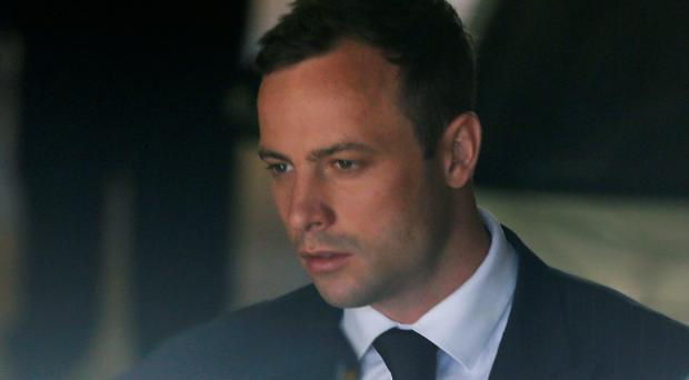 Oscar Pistorius after being told of his prison sentence. Photo credit: REUTERS/Mike Hutchings