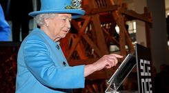 Queen Elizabeth II sends the first royal tweet under her own name to declare the opening of the new Information Age Galleries at the Science Museum, South Kensington, London
