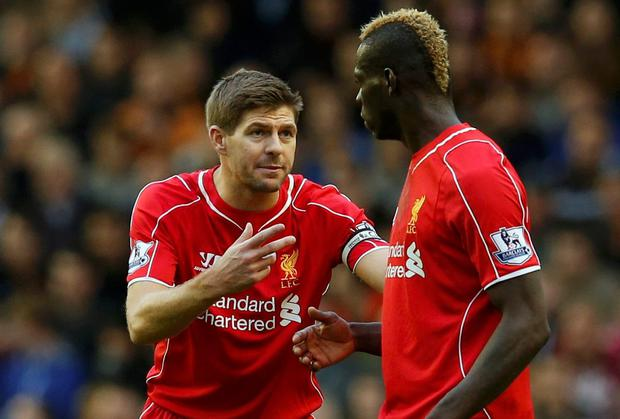 Liverpool captain Steven Gerrard speaks with teammate Mario Balotelli. Photo credit: REUTERS/Phil Noble