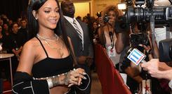 Recording artist Rihanna attends ROGUE MAN Fragrance Launch at Macy's at Lenox Square