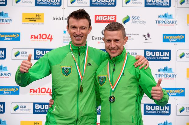 27 October 2014; Barry Minnock, Rathfarnham AC, who finished as the second Irish finisher in the men's race and Eoin Flynn, Rathfarnham AC, left, who finished as the third Irish finisher at the SSE Airtricity Dublin Marathon 2014. Merrion Square, Dublin. Picture credit: Pat Murphy / SPORTSFILE