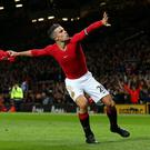 Robin van Persie of Manchester United celebrates scoring the equalising goal during the Barclays Premier League match between Manchester United and Chelsea at Old Trafford