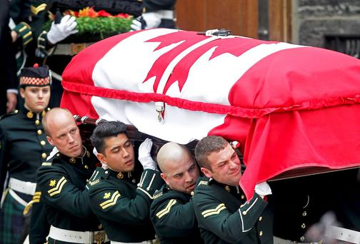 Soldiers carry the coffin of Cpl Nathan Cirillo from the church following his funeral service. The Canadian soldier was shot dead last week, while on ceremonial duty, in a suspected terrorist attack . REUTERS/Fred Thornhill