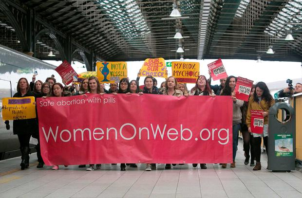 Pro Choice activists after arriving from Belfast after bringing back abortion pills denied to women in the Republic of Ireland at Connolly Station, Dublin. Photo: Gareth Chaney Collins