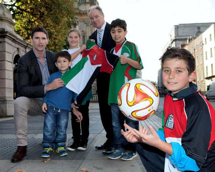 Former Ireland manager Brian Kerr and former rugby international Trevor Hogan launch 'Gaza Kids to Ireland' with the help of a group of Palestinian footballers in Dublin yesterday