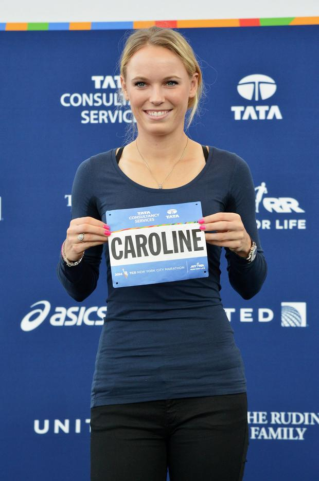 Tennis player Caroline Wozniacki picks up her New York City Marathon official race bib at The Jacob K. Javits Convention Center