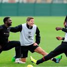 Steven Gerrard talks with Mario Balotelli and Kolo Toure during a training session at Melwood yesterday. John Powell/Liverpool FC via Getty Images